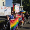 Protesters bring their rainbow flags to the office of Senator Eric Abetz