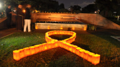 Intl AIDS Candlelight Memorial: We remember, we live beyond HIV