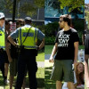 Police Ask Protestors to Remove Anti-Abbott T-Shirts