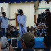 Two gay men publicly flogged in Aceh Indonesia