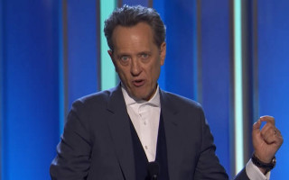 Richard E Grant dedicates Independent Spirit Award to generation lost to AIDS