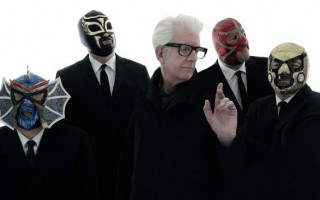 On the Line: Nick Lowe tells us why he teamed up with Los Straitjackets