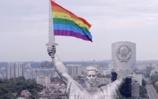 Activists defiantly fly Pride flag from Ukraine national monument