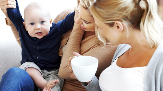 Lesbian couple with their kid having fun at home