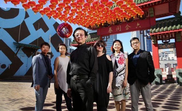 Artistic crew behind the Black Swan Theatre Company's collaboration with National Theatre of China director Dr Wang Xiaoying (centre). L-R Tao Chen (Asst Dtr), Felix Ching Ching Ho (Asst Dtr), Dr Wang, Kate Cherry (Artistic Dtr BSTC), Zhao Yan (Costumes), Zhang Huaxiang (Masks & Props). Photographed at Chinatown, Northbridge, Perth, WA; 4th February 2016. Photographed by Philip Gostelow.