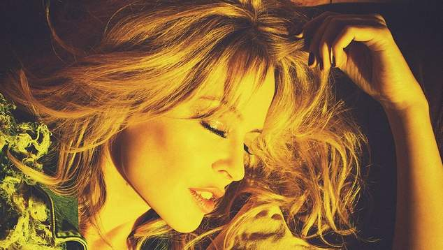 Kylie Minogue Shares 'Stop Me From Falling' Video